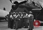 Image of Douglas SBD Dauntless aircraft start and taxi Pearl Harbor Hawaii USA, 1942, second 4 stock footage video 65675061841