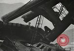 Image of Workers removing foremast of USS Arizona Pearl Harbor Hawaii USA, 1942, second 24 stock footage video 65675061864