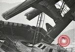Image of Workers removing foremast of USS Arizona Pearl Harbor Hawaii USA, 1942, second 32 stock footage video 65675061864