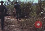 Image of sentry dogs South Vietnam, 1967, second 32 stock footage video 65675062007