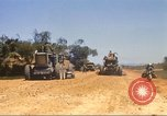 Image of construction of highway Vietnam, 1969, second 11 stock footage video 65675062015