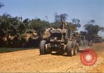 Image of construction of highway Vietnam, 1969, second 21 stock footage video 65675062015