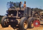 Image of construction of highway Vietnam, 1969, second 23 stock footage video 65675062015