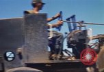 Image of construction of highway Vietnam, 1969, second 25 stock footage video 65675062015
