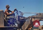 Image of construction of highway Vietnam, 1969, second 26 stock footage video 65675062015