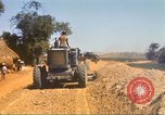 Image of construction of highway Vietnam, 1969, second 44 stock footage video 65675062015
