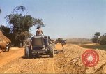 Image of construction of highway Vietnam, 1969, second 46 stock footage video 65675062015