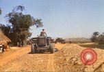 Image of construction of highway Vietnam, 1969, second 49 stock footage video 65675062015