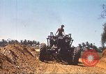 Image of construction of highway Vietnam, 1969, second 54 stock footage video 65675062015