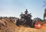 Image of construction of highway Vietnam, 1969, second 55 stock footage video 65675062015