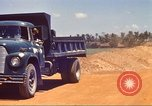 Image of construction of highway Vietnam, 1969, second 19 stock footage video 65675062016