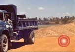 Image of construction of highway Vietnam, 1969, second 21 stock footage video 65675062016