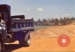 Image of construction of highway Vietnam, 1969, second 22 stock footage video 65675062016