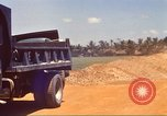 Image of construction of highway Vietnam, 1969, second 23 stock footage video 65675062016