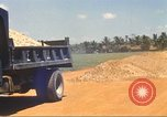 Image of construction of highway Vietnam, 1969, second 31 stock footage video 65675062016