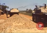 Image of construction of highway Vietnam, 1969, second 53 stock footage video 65675062016
