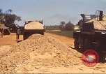 Image of construction of highway Vietnam, 1969, second 54 stock footage video 65675062016