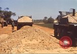 Image of construction of highway Vietnam, 1969, second 55 stock footage video 65675062016