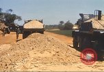 Image of construction of highway Vietnam, 1969, second 57 stock footage video 65675062016