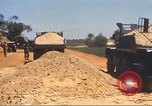 Image of construction of highway Vietnam, 1969, second 58 stock footage video 65675062016