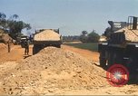 Image of construction of highway Vietnam, 1969, second 61 stock footage video 65675062016