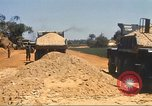 Image of construction of highway Vietnam, 1969, second 62 stock footage video 65675062016