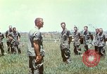 Image of Memorial ceremony for fallen of 199th Light Infantry Brigade South Vietnam, 1968, second 51 stock footage video 65675062054