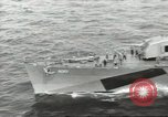 Image of Wounded transferred, ship-to-ship, on Stokes stretcher Mariana Islands, 1944, second 1 stock footage video 65675062229