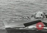 Image of Wounded transferred, ship-to-ship, on Stokes stretcher Mariana Islands, 1944, second 5 stock footage video 65675062229