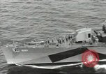 Image of Wounded transferred, ship-to-ship, on Stokes stretcher Mariana Islands, 1944, second 7 stock footage video 65675062229