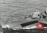 Image of Wounded transferred, ship-to-ship, on Stokes stretcher Mariana Islands, 1944, second 8 stock footage video 65675062229