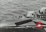 Image of Wounded transferred, ship-to-ship, on Stokes stretcher Mariana Islands, 1944, second 13 stock footage video 65675062229
