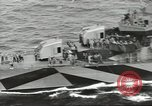 Image of Wounded transferred, ship-to-ship, on Stokes stretcher Mariana Islands, 1944, second 17 stock footage video 65675062229
