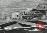 Image of Wounded transferred, ship-to-ship, on Stokes stretcher Mariana Islands, 1944, second 18 stock footage video 65675062229