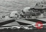 Image of Wounded transferred, ship-to-ship, on Stokes stretcher Mariana Islands, 1944, second 20 stock footage video 65675062229