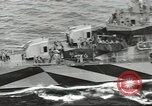 Image of Wounded transferred, ship-to-ship, on Stokes stretcher Mariana Islands, 1944, second 23 stock footage video 65675062229