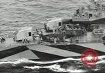 Image of Wounded transferred, ship-to-ship, on Stokes stretcher Mariana Islands, 1944, second 24 stock footage video 65675062229