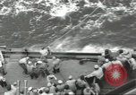 Image of Wounded transferred, ship-to-ship, on Stokes stretcher Mariana Islands, 1944, second 25 stock footage video 65675062229