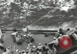 Image of Wounded transferred, ship-to-ship, on Stokes stretcher Mariana Islands, 1944, second 26 stock footage video 65675062229