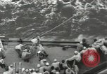 Image of Wounded transferred, ship-to-ship, on Stokes stretcher Mariana Islands, 1944, second 27 stock footage video 65675062229