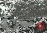 Image of Wounded transferred, ship-to-ship, on Stokes stretcher Mariana Islands, 1944, second 28 stock footage video 65675062229