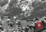 Image of Wounded transferred, ship-to-ship, on Stokes stretcher Mariana Islands, 1944, second 29 stock footage video 65675062229