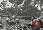 Image of Wounded transferred, ship-to-ship, on Stokes stretcher Mariana Islands, 1944, second 30 stock footage video 65675062229