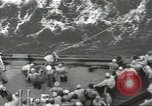 Image of Wounded transferred, ship-to-ship, on Stokes stretcher Mariana Islands, 1944, second 31 stock footage video 65675062229
