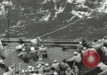 Image of Wounded transferred, ship-to-ship, on Stokes stretcher Mariana Islands, 1944, second 32 stock footage video 65675062229
