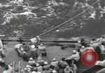 Image of Wounded transferred, ship-to-ship, on Stokes stretcher Mariana Islands, 1944, second 33 stock footage video 65675062229