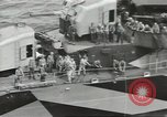 Image of Wounded transferred, ship-to-ship, on Stokes stretcher Mariana Islands, 1944, second 34 stock footage video 65675062229