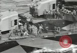 Image of Wounded transferred, ship-to-ship, on Stokes stretcher Mariana Islands, 1944, second 35 stock footage video 65675062229