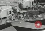 Image of Wounded transferred, ship-to-ship, on Stokes stretcher Mariana Islands, 1944, second 36 stock footage video 65675062229