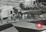 Image of Wounded transferred, ship-to-ship, on Stokes stretcher Mariana Islands, 1944, second 37 stock footage video 65675062229